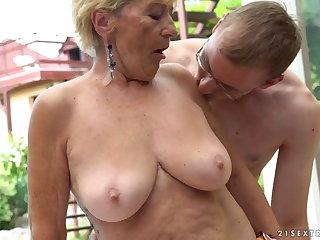 Granny fucks next to a pool