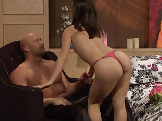 Asian babe in thongs gives a hardcore blowjob and rides wildly