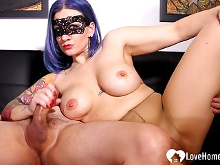 Blue-haired mistress gives a oral sex to her stud