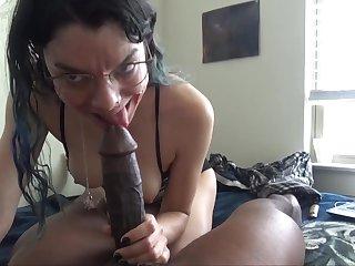 White chick enjoys choking on a big black knob