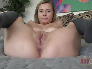Carolina Sweets show shaved pussy on bed